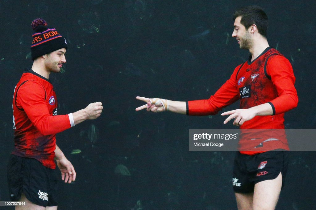 Kyle Langford (R) of the Bombers, sent to hospital after his match on Friday against the Sydney Swans, takes part in Paper, Rock, Scissors with Ben McNeice during an Essendon Bombers AFL training session at The Hangar on July 30, 2018 in Melbourne, Australia.