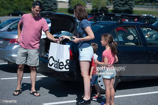 Kyle Larabee and Lena Kozoloski of Cambridge took advantage of a tax free weekend to pick up a new grill at the Burlington Mall Saturday August 10...