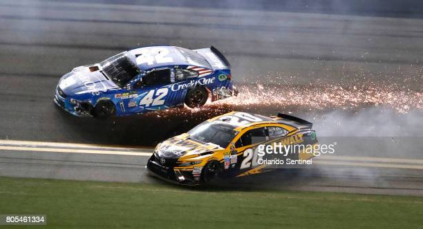 Kyle Larson and Matt Kenseth tangle in a multicar crash with six laps left in the NASCAR Coke Zero 400 at Daytona International Speedway in Daytona...