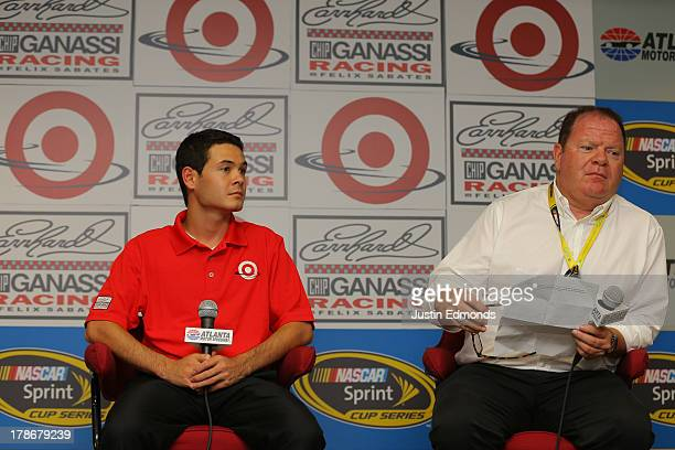 Kyle Larson and team owner Chip Ganassi speak during a press conference announcing his move to the Target Chevrolet during practice for the NASCAR...