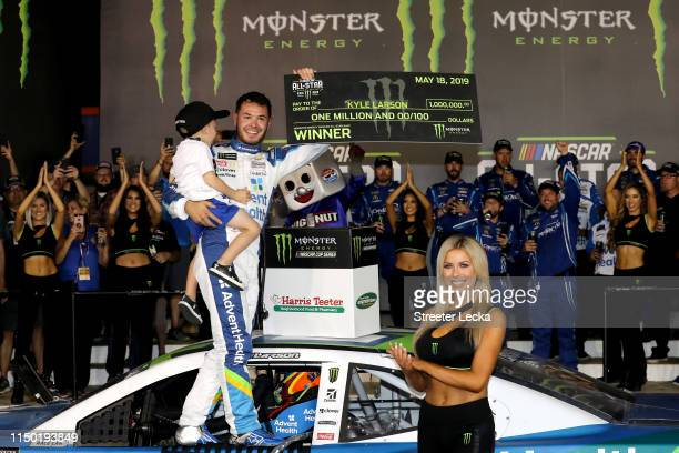 Kyle Larson driver of the Advent Health Chevrolet celebrates with his son Owen in Victory Lane after winning the Monster Energy NASCAR Cup Series...
