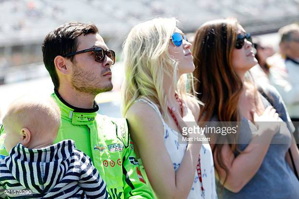 Kyle Larson driver of the BELKIN Chevrolet takes part in prerace ceremonies with girlfriend Katelyn Sweet and son Owen prior to the NASCAR XFINITY...