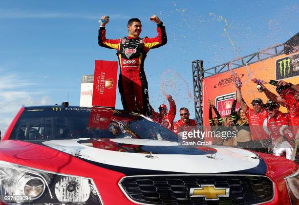 Kyle Larson driver of the Cars 3/Target Chevrolet celebrates in Victory Lane after winning the Monster Energy NASCAR Cup Series FireKeepers Casino...