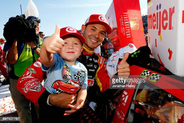 Kyle Larson driver of the Cars 3/Target Chevrolet celebrates with his son Owen in Victory Lane after winning the Monster Energy NASCAR Cup Series...