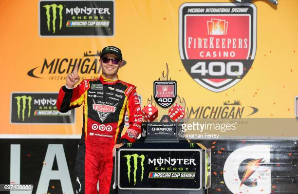 Kyle Larson driver of the Cars 3/Target Chevrolet celebrates with the trophy in Victory Lane after winning the Monster Energy NASCAR Cup Series...