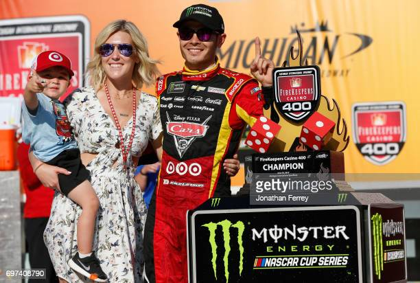 Kyle Larson driver of the Cars 3/Target Chevrolet girlfriend Katelyn Sweet and son Owen celebrate with the trophy in Victory Lane after winning the...