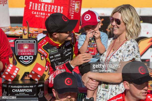 Kyle Larson driver of the Cars 3/Target Chevrolet tickles his son during the awards ceremony following the conclusion of the Monster Energy Cup...