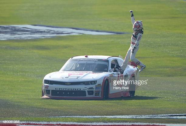 Kyle Larson driver of the Cartwheel Chevrolet celebrates after winning the NASCAR Nationwide Series TREATMYCLOTCOM 300 at Auto Club Speedway on March...