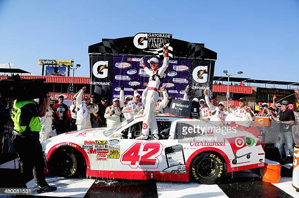 Kyle Larson driver of the Cartwheel Chevrolet celebrates in Victory Lane after winning the NASCAR Nationwide Series TREATMYCLOTCOM 300 at Auto Club...