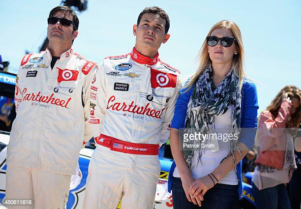 Kyle Larson driver of the Cartwheel Chevrolet center stands with girlfriend Katelyn Sweet right and crew chief Scott Zipadelli during prerace...