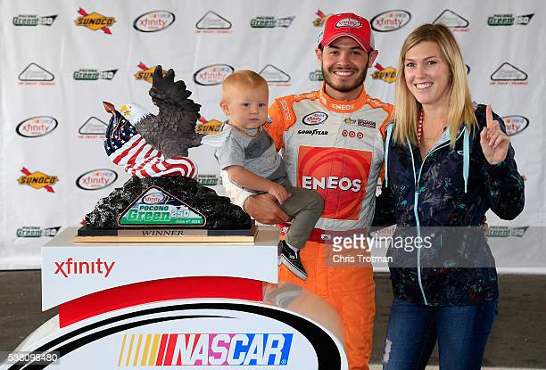 Kyle Larson driver of the Cessna/NTT Data Group Chevrolet poses with his girlfriend Katelyn Sweet and son Owen in an alternate Victory Lane after...