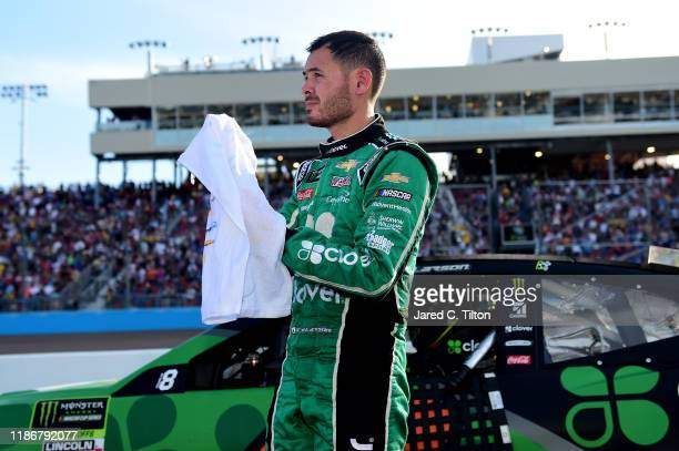Kyle Larson, driver of the Clover Chevrolet, stands on the grid after failing to make the championship race following the Monster Energy NASCAR Cup...