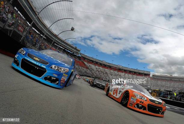 Kyle Larson driver of the Credit One Bank Chevrolet and Chase Elliott driver of the Mountain Dew/Little Caesars Chevrolet lead the field under...