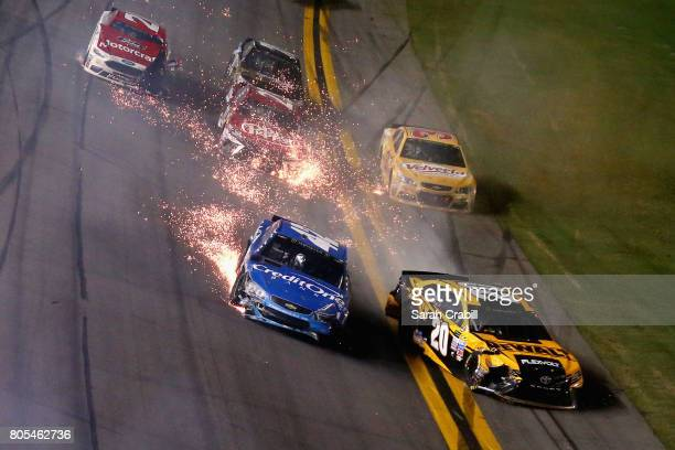 Kyle Larson driver of the Credit One Bank Chevrolet and Matt Kenseth driver of the DEWALT Flexvolt Toyota are involved in an ontrack incident during...