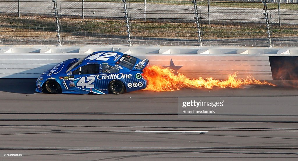 kyle larson driver of the credit one bank chevrolet is involved in