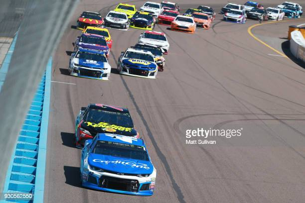 Kyle Larson driver of the Credit One Bank Chevrolet leads the field during the Monster Energy NASCAR Cup Series TicketGuardian 500 at ISM Raceway on...