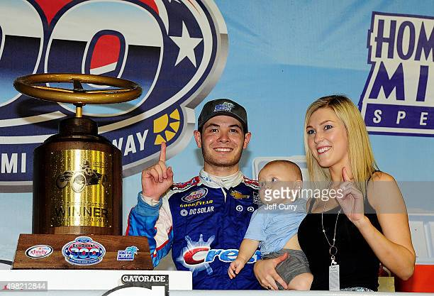 Kyle Larson driver of the Crest Chevrolet celebrates in Victory Lane with son Owen and girlfriend Katelyn Sweet after winning during the NASCAR...