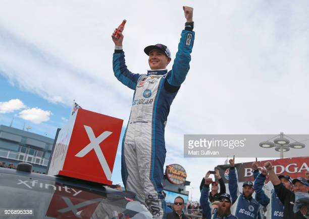 Kyle Larson driver of the DC Solar Chevrolet celebrates in victory lane after winning the NASCAR Xfinity Series Boyd Gaming 300 at Las Vegas Motor...