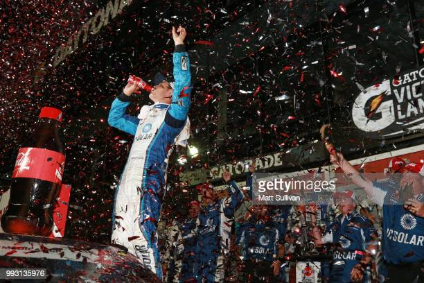 Kyle Larson driver of the DC Solar Chevrolet celebrates in Victory Lane after winning the NASCAR Xfinity Series CocaCola Firecracker 250 at Daytona...