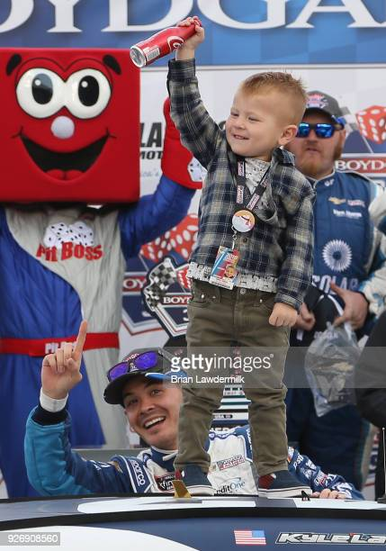Kyle Larson driver of the DC Solar Chevrolet celebrates with his son Owen after winning the NASCAR Xfinity Series Boyd Gaming 300 at Las Vegas Motor...