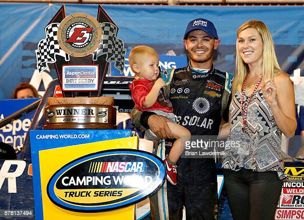 Kyle Larson driver of the DC Solar Chevrolet Owen Larson and Katelyn Sweet pose with the NASCAR Camping World Series 4th Annual Aspen Dental Eldora...