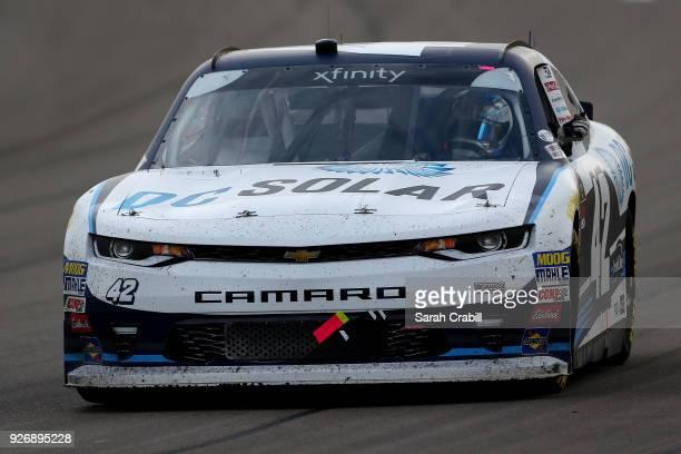 Kyle Larson driver of the DC Solar Chevrolet waves to the crowd after winning the NASCAR Xfinity Series Boyd Gaming 300 at Las Vegas Motor Speedway...