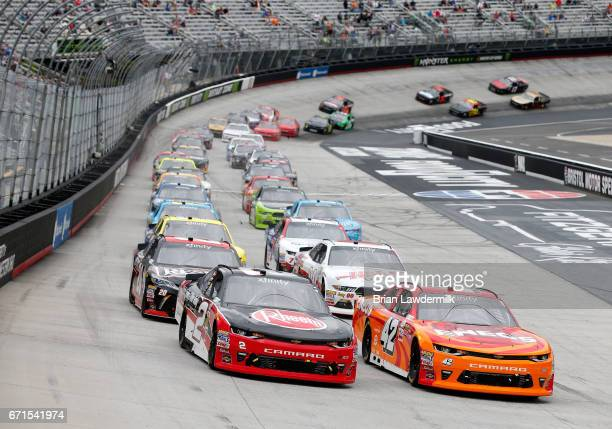 Kyle Larson driver of the ENEOS Chevrolet and Austin Dillon driver of the Rheem Chevrolet take the green flag to start the NASCAR XFINITY Series...