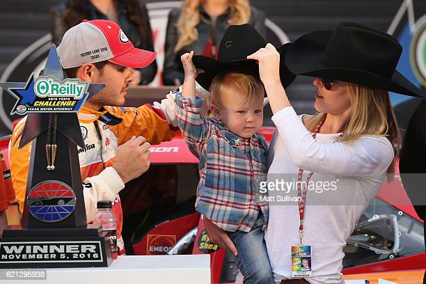 Kyle Larson driver of the ENEOS Chevrolet celebrates in Victory Lane after winning with his son Owen and girlfriend Katelyn Sweet after winning the...