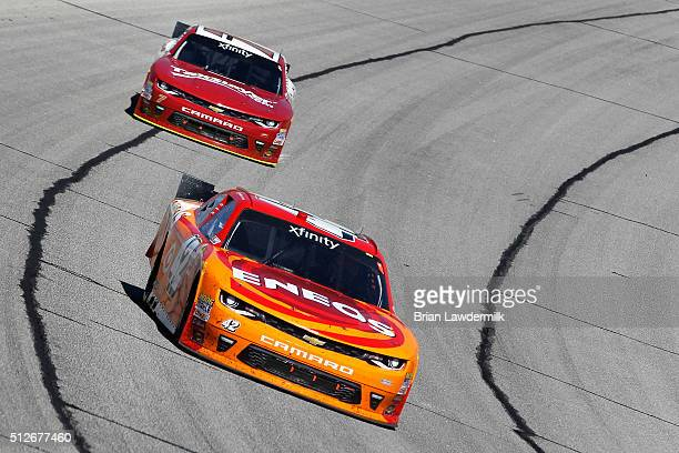 Kyle Larson driver of the ENEOS Chevrolet leads Justin Allgaier driver of the TaxSlayercom Chevrolet during the NASCAR XFINITY Series Heads Up...