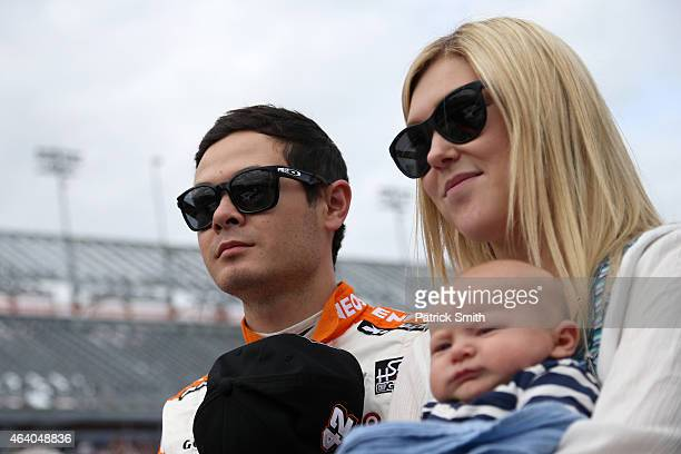 Kyle Larson driver of the ENEOS Chevrolet takes part in prerace ceremonies with girlfriend Katelyn Sweet and son Owen prior to the NASCAR XFINITY...