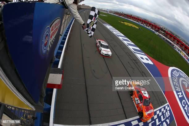 Kyle Larson, driver of the ENEOS Chevrolet, takes the checkered flag to win the NASCAR XFINITY Series Service King 300 at Auto Club Speedway on March...