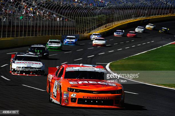Kyle Larson driver of the ENOES Chevrolet leads the field during the NASCAR Nationwide Series History 300 at Charlotte Motor Speedway on May 24 2014...
