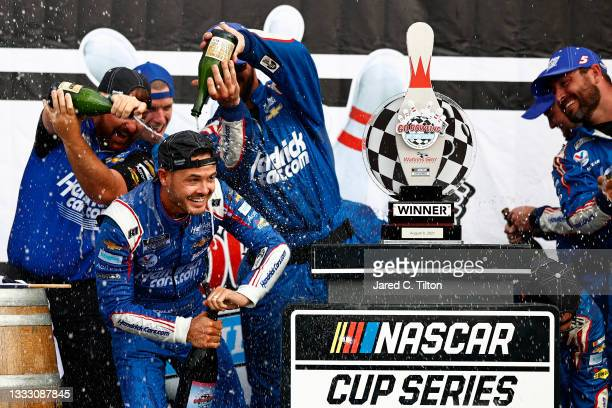 Kyle Larson, driver of the HendrickCars.com Chevrolet, and crew celebrate in the Ruoff Mortgage victory lane after winning the NASCAR Cup Series Go...