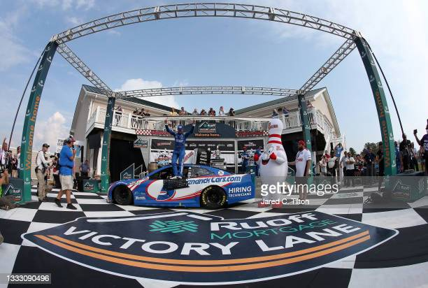 Kyle Larson, driver of the HendrickCars.com Chevrolet, celebrates in the Ruoff Mortgage victory lane after winning the NASCAR Cup Series Go Bowling...