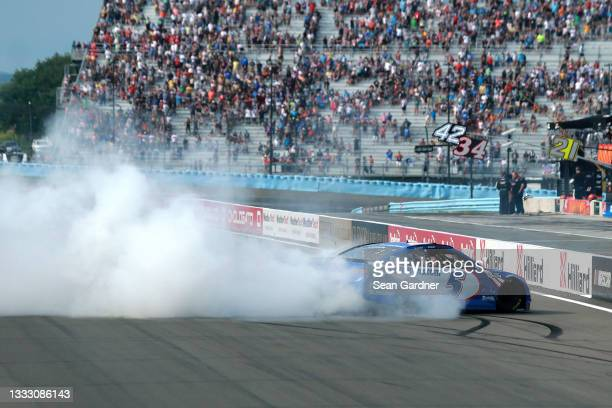 Kyle Larson, driver of the HendrickCars.com Chevrolet, celebrates with a burnout after winning the NASCAR Cup Series Go Bowling at The Glen at...
