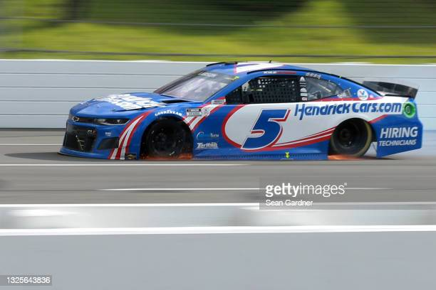 Kyle Larson, driver of the HendrickCars.com Chevrolet, drives with a flat tire on the final turn of the NASCAR Cup Series Pocono Organics CBD 325 at...