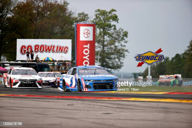 Kyle Larson, driver of the HendrickCars.com Chevrolet, leads Bubba Wallace, driver of the Toyota Toyota, during the NASCAR Cup Series Go Bowling at...