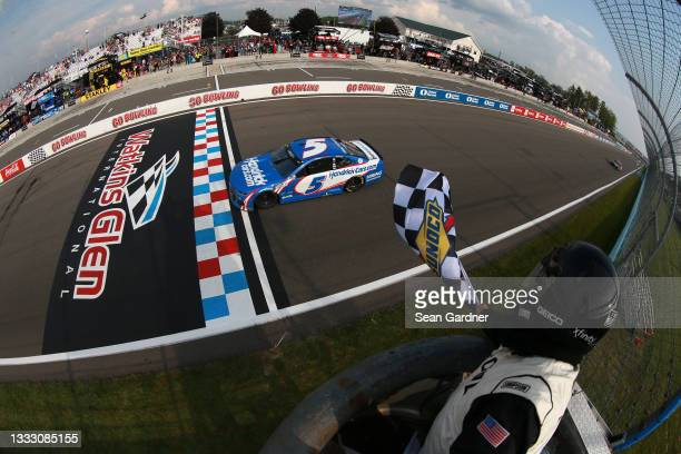 Kyle Larson, driver of the HendrickCars.com Chevrolet, takes the checkered flag to win the NASCAR Cup Series Go Bowling at The Glen at Watkins Glen...