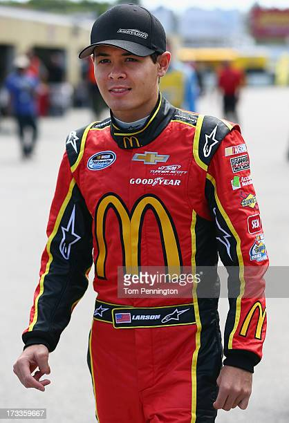 Kyle Larson driver of the McDonald's Chevrolet walks in the garage area during practice for the NASCAR Nationwide Series CNBC Prime's 'The Profit'...