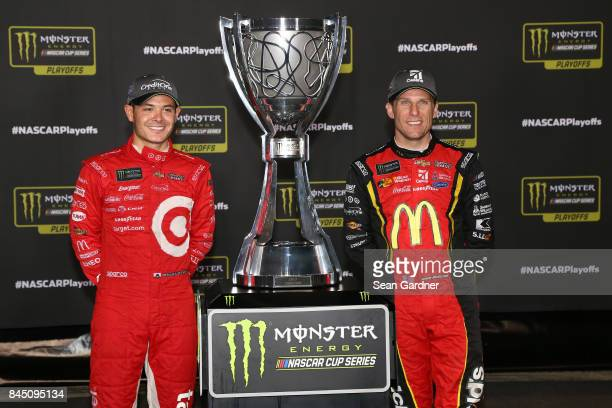 Kyle Larson driver of the Target Chevrolet and Jamie McMurray driver of the McDonald's Chevrolet pose with the Monster Energy Series Championship...