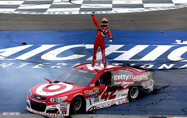 Kyle Larson driver of the Target Chevrolet celebrates after winning the NASCAR Sprint Cup Series Pure Michigan 400 at Michigan International Speedway...
