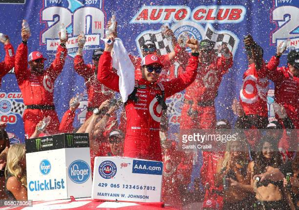 Kyle Larson driver of the Target Chevrolet celebrates in victory land after winning the Monster Energy NASCAR Cup Series Auto Club 400 at Auto Club...