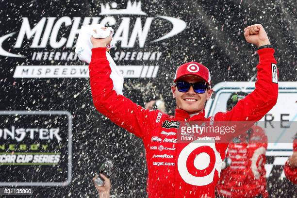 Kyle Larson driver of the Target Chevrolet celebrates in Victory Lane after winning the Monster Energy NASCAR Cup Series Pure Michigan 400 at...