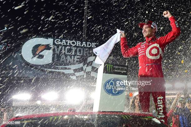 Kyle Larson driver of the Target Chevrolet celebrates in Victory Lane after winning the Monster Energy NASCAR Cup Series Federated Auto Parts 400 at...
