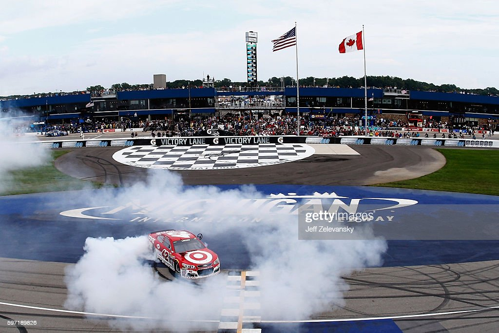 Kyle Larson, driver of the #42 Target Chevrolet, celebrates with a burnout after winning the NASCAR Sprint Cup Series Pure Michigan 400 at Michigan International Speedway on August 28, 2016 in Brooklyn, Michigan.