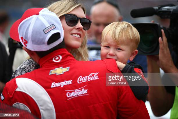 Kyle Larson driver of the Target Chevrolet gets a hug from his girlfriend Katelyn Sweet and son Owne before the Monster Energy NASCAR Cup Series Auto...