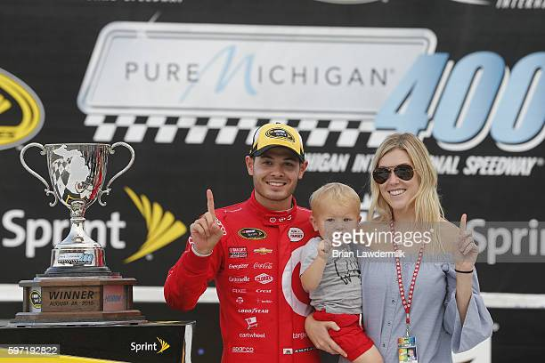 Kyle Larson driver of the Target Chevrolet girlfriend Katelyn Sweet and son Owen Larson celebrate in Victory Lane after winning the NASCAR Sprint Cup...