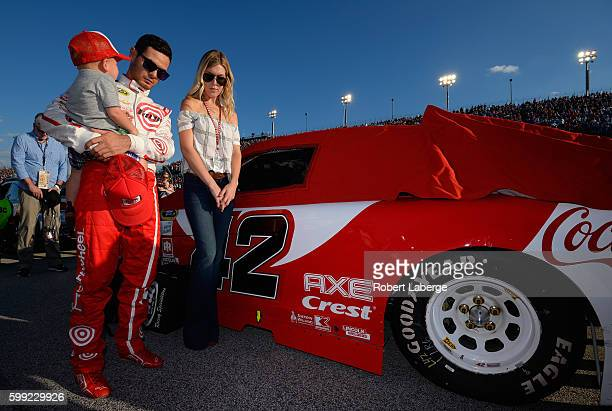 Kyle Larson driver of the Target Chevrolet girlfriend Katelyn Sweet and son Owen Larson participate in the pre race ceremony prior to the NASCAR...