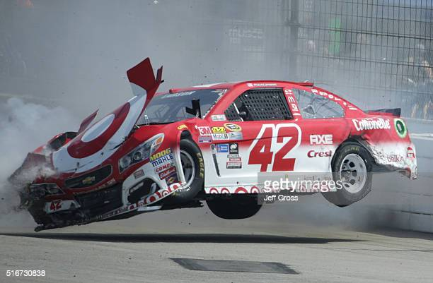 Kyle Larson driver of the Target Chevrolet is involved in an ontrack incident during the NASCAR Sprint Cup Series Auto Club 400 at Auto Club Speedway...
