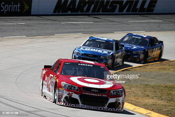 Kyle Larson driver of the Target Chevrolet Jimmie Johnson driver of the Lowe's Chevrolet and Brian Vickers driver of the Janssen/Arnie's Army...